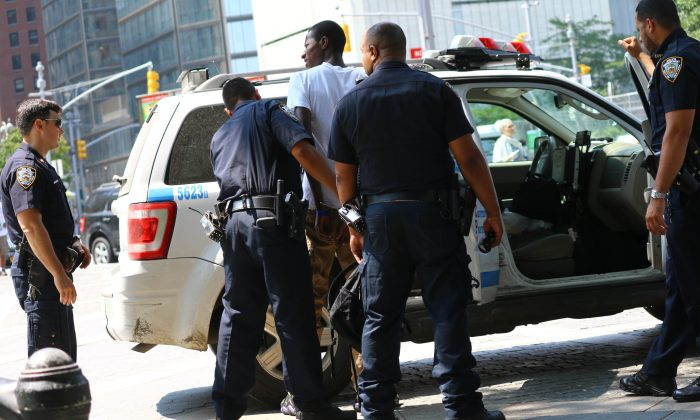 Roaming vendor Mahamadou Soukoua, 21, arrested by police for unlawfully soliciting bicycles and pedicabs without a Department of Consumer Affairs License, Central Park entrance, Wednesday. (Brendon Fallon/Epoch Times)