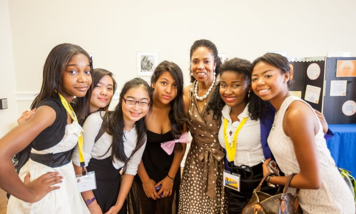 Barbara Murphy-Warrington, chief executive officer of the Girl Scouts of Greater New York, poses for a picture with Girl Scouts members at the Girl Scouts Leadership Institute Entrepreneurship Summer Intensive program at Barnard Hall, New York City, July 24, 2014. (Petr Svab/Epoch Times)