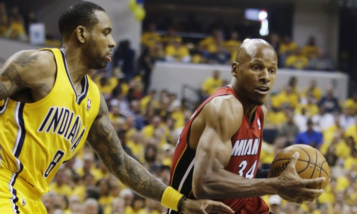 Miami Heat guard Ray Allen (34) drives around Indiana Pacers guard Rasual Butler (8) during the first half of Game 1 of the Eastern Conference finals NBA basketball playoff series in Indianapolis on May 18, 2014.  (AP Photo/Darron Cummings)
