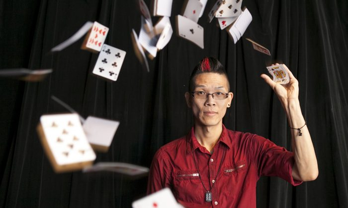 """Roger Quan, also known as Rogue, at his magic shop in Elmhurst, Queens, on July 15. Rogue has performed his tricks on """"America's Got Talent."""" (Samira Bouaou/Epoch Times)"""
