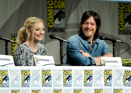 """An article saying the Walking Dead has agreed to """"bring Beth Greene back to life"""" is fake.  Emily Kinney, left, and Norman Reedus attend """"The Walking Dead"""" panel on Day 2 of Comic-Con International on Friday, July 25, 2014, in San Diego. (Chris Pizzello/Invision/AP)"""