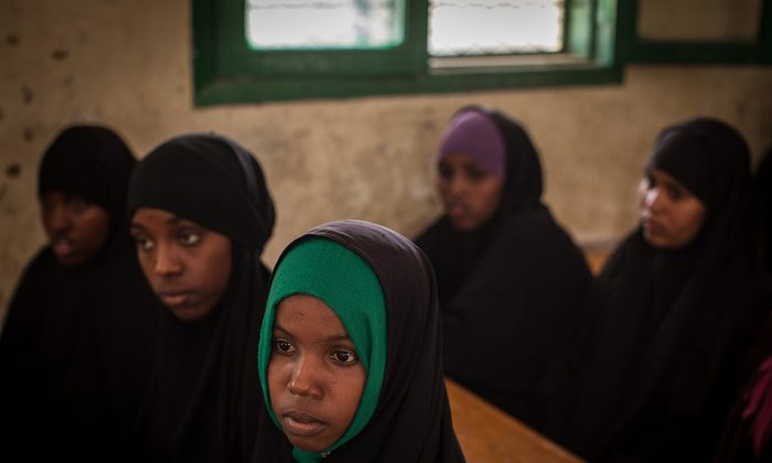Women take part with other young women and men in a discussion on female genital mutilation (FGM) at an after school program for children's rights in northern Somalia on Feb. 19, 2014. (Nichole Sobecki/AFP/Getty Images)