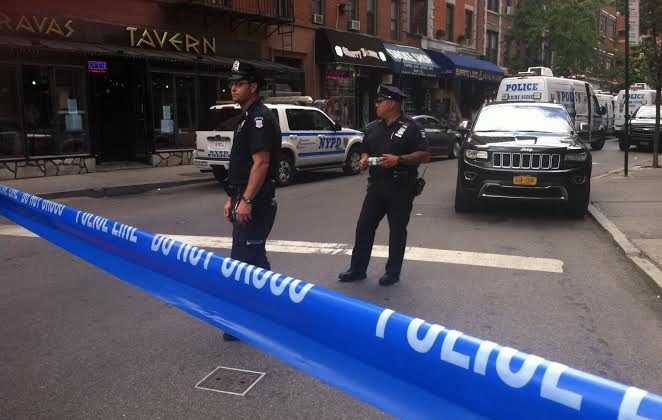 The crime scene in West Village where three law enforcement members were injured in an attempt to arrest a sex offender from California. (Genevieve Belmaker/Epoch Times)