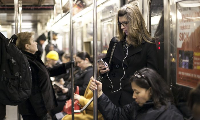 Subway riders in New York City, April 1, 2014. (Samira Bouaou/Epoch Times)