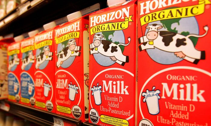 Cartons of Horizon organic milk sit on a cooler shelf in the Shop & Save Market grocery store in Des Plaines, Illinois. Recently the Organic Consumer's Association (OCA) urged Horizon and other organic milk companies to sever ties with IDFA. (Tim Boyle/Getty Images)