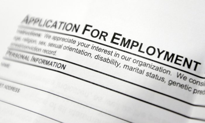 An employment application form on a table during a job fair at Columbia-Greene Community College in Hudson, N.Y., on April 22, 2014. (AP Photo/Mike Groll)