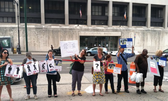 Advocates call for the prosecution of Rikers Island officers who were responsible for the death of a mentally ill inmate, in front of the Bronx, New York district attorney's office on Thursday, July 31, 2014. Bradley Ballard died last September after spending seven days in solitary confinement without access to his medication. (Annie Wu/Epoch Times)