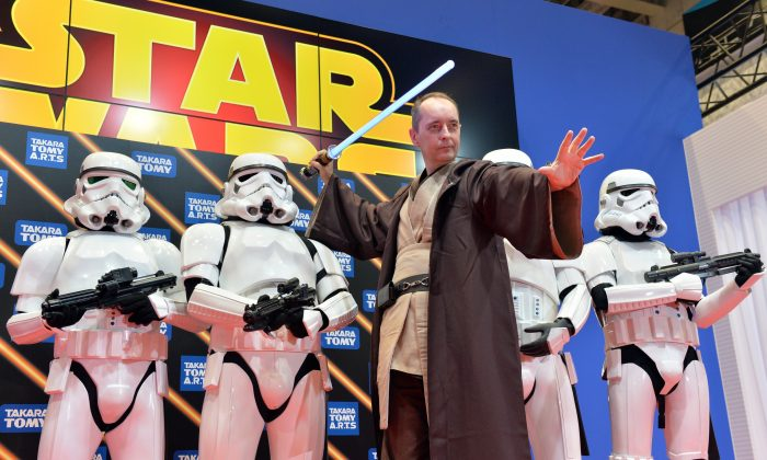 Japan's toy maker Tomy executive vice president and new chief operating officer (COO) Harold George Meij (C) poses with stom troopers as they introduce the new line up of Star Wars toys at the Tokyo Toy Show in Tokyo on June 12, 2014. Consumers are rebelling against the new Star Wars but Lucasfilm doesn't have to yield to them. (YOSHIKAZU TSUNO/AFP/Getty Images)