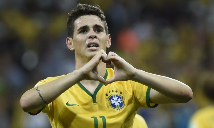 Brazil's midfielder Oscar celebrates after scoring a goal during a Group A football match between Brazil and Croatia at the Corinthians Arena in Sao Paulo during the 2014 FIFA World Cup on June 12, 2014. (ODD ANDERSEN/AFP/Getty Images)