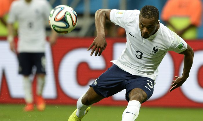France's Patrice Evra kicks the ball during a Group E football match between Switzerland and France at the Fonte Nova Arena in Salvador during the 2014 FIFA World Cup on June 20, 2014. (FRANCK FIFE/AFP/Getty Images)