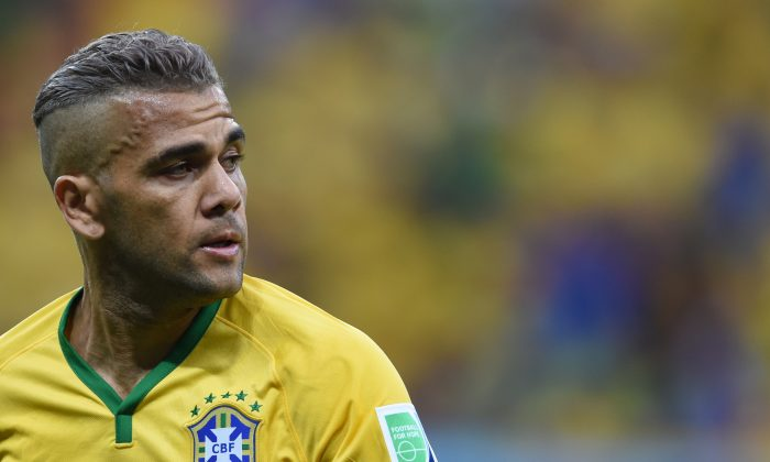 Brazil's defender Dani Alves reacts during a Group A football match between Cameroon and Brazil at the Mane Garrincha National Stadium in Brasilia during the 2014 FIFA World Cup on June 23, 2014. Brazil won 4 to 1 (FRANCOIS XAVIER MARIT/AFP/Getty Images)