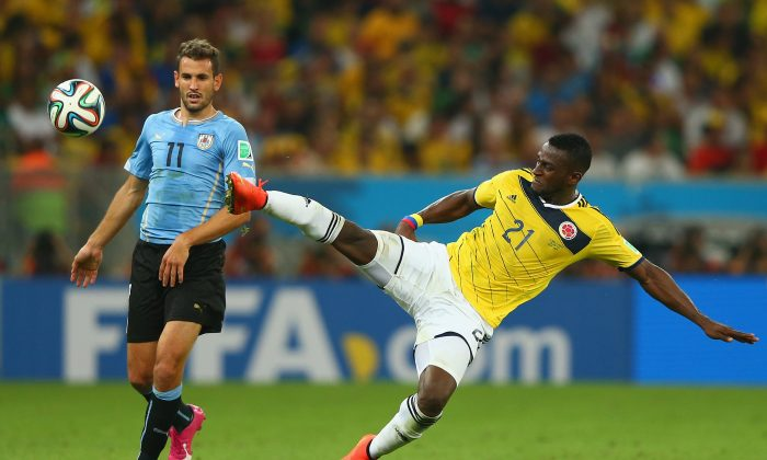 Jackson Martinez of Colombia controls the ball as Christian Stuani of Uruguay looks on during the 2014 FIFA World Cup Brazil round of 16 match between Colombia and Uruguay at Maracana on June 28, 2014 in Rio de Janeiro, Brazil. (Jamie Squire/Getty Images)