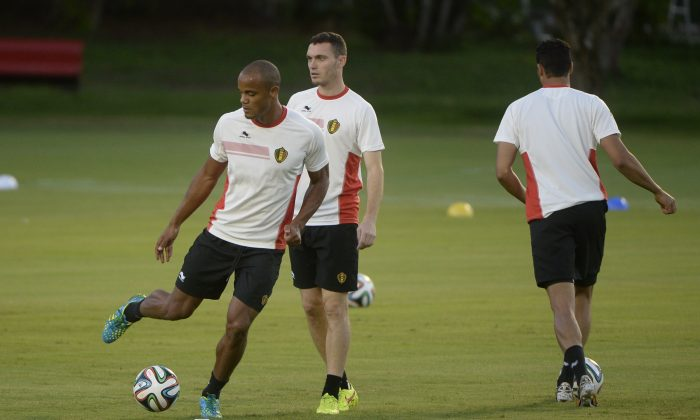 Belgium's defender Vincent Kompany (L) and Belgium's defender Thomas Vermaelen play with the ball during a training session in Salvador on June 30, 2014, on the eve of the 2014 FIFA World Cup round of 16 football match Belgium vs USA. (MARTIN BUREAU/AFP/Getty Images)