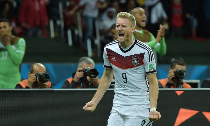 Germany's forward Andre Schuerrle celebrates after scoring a goal during the first half of extra-time in the Round of 16 football match between Germany and Algeria at Beira-Rio Stadium in Porto Alegre during the 2014 FIFA World Cup on June 30, 2014. (GABRIEL BOUYS/AFP/Getty Images)