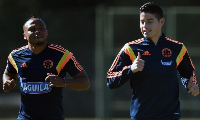 Colombia's defender Juan Camilo Zuniga (L) and midfielder James Rodriguez take part in a training session at the President Laudo Natel Athlete Formation Center in Cotia, Sao Paulo, on July 1, 2014, during the 2014 FIFA World Cup in Brazil. (EITAN ABRAMOVICH/AFP/Getty Images)