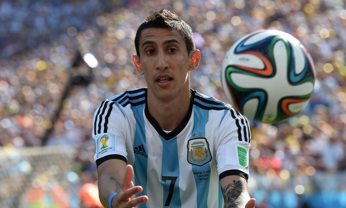 Argentina's midfielder Angel Di Maria catches the ball during a Round of 16 football match between Argentina and Switzerland at Corinthians Arena in Sao Paulo during the 2014 FIFA World Cup on July 1, 2014. (NELSON ALMEIDA/AFP/Getty Images)