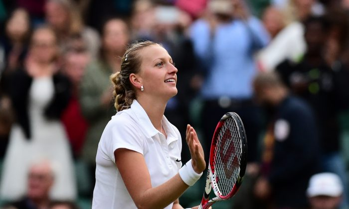 Czech Republic's Petra Kvitova celebrates winning her women's singles quarter-final match against Czech Republic's Barbora Zahlavova Strycova on day eight of the 2014 Wimbledon Championships at The All England Tennis Club in Wimbledon, southwest London, on July 1, 2014. Kvitova won 6-3, 7-5. (CARL COURT/AFP/Getty Images)