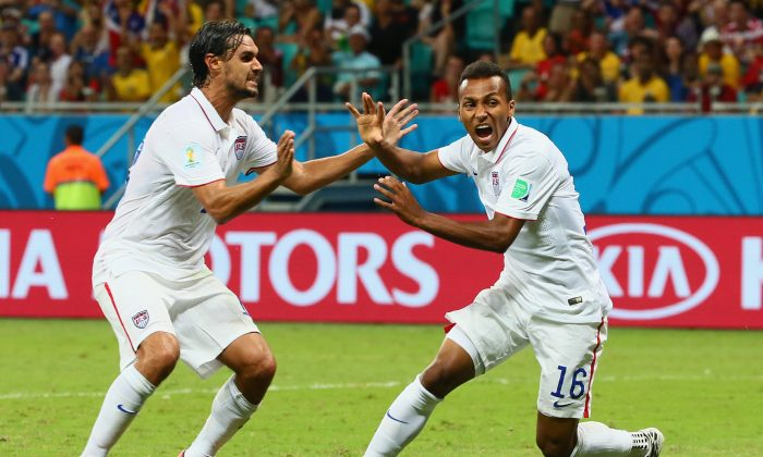 Julian Green of the United States (R) celebrates scoring his team's first goal in extra time with Chris Wondolowski during the 2014 FIFA World Cup Brazil Round of 16 match between Belgium and the United States at Arena Fonte Nova on July 1, 2014 in Salvador, Brazil. (Kevin C. Cox/Getty Images)