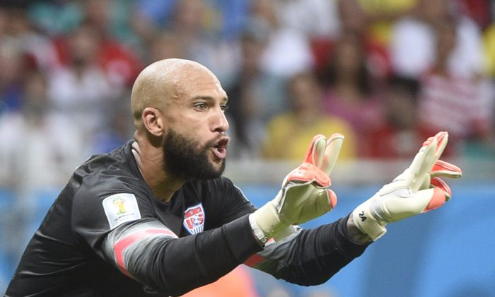 US goalkeeper Tim Howard reacts during a Round of 16 football match between Belgium and USA at Fonte Nova Arena in Salvador during the 2014 FIFA World Cup on July 1, 2014. (MARTIN BUREAU/AFP/Getty Images)