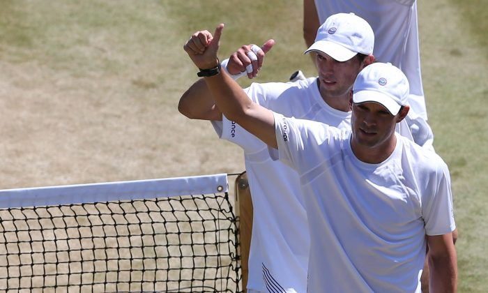 US players Bob Bryan and Mike Bryan celebrate after winning their men's doubles semi-final match against France's Nicolas Mahut and Michael Llodra on day 11 of the 2014 Wimbledon Championships at The All England Tennis Club in Wimbledon, southwest London, on July 4, 2014. The Bryan brothers won 7-6, 6-3, 6-2. (ANDREW COWIE/AFP/Getty Images)