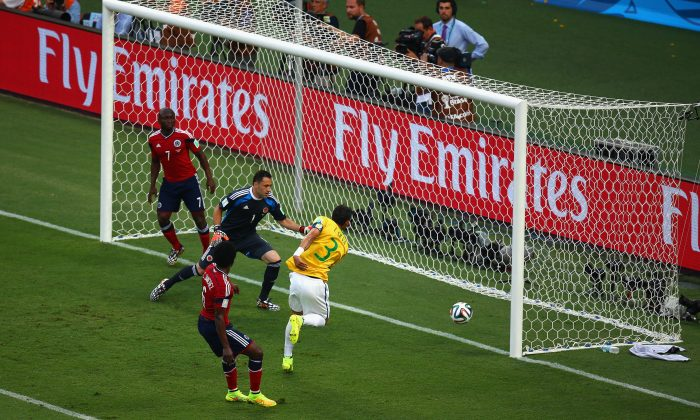 Thiago Silva of Brazil scores his team's first goal past David Ospina of Colombia during the 2014 FIFA World Cup Brazil Quarter Final match between Brazil and Colombia at Castelao on July 4, 2014 in Fortaleza, Brazil. (Michael Steele/Getty Images)
