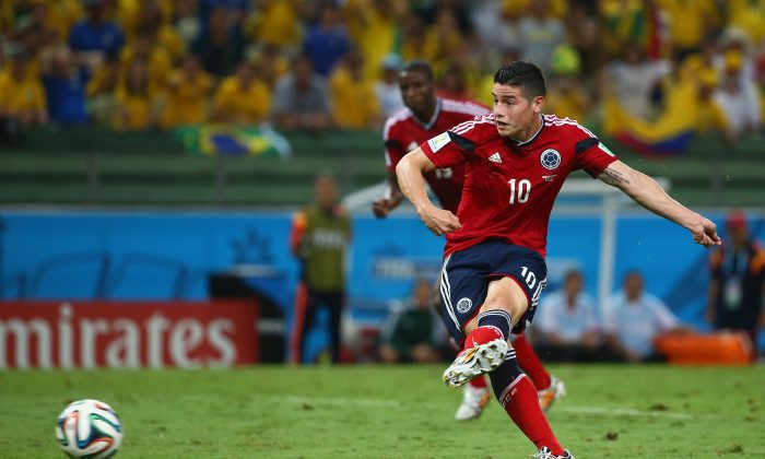 James Rodriguez of Colombia shoots and scores his team's first goal on a penalty kick during the 2014 FIFA World Cup Brazil Quarter Final match between Brazil and Colombia at Castelao on July 4, 2014 in Fortaleza, Brazil. (Robert Cianflone/Getty Images)