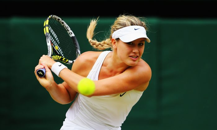 Eugenie Bouchard of Canada plays a backhand return during the Ladies' Singles final match against Petra Kvitova of Czech Republic on day twelve of the Wimbledon Lawn Tennis Championships at the All England Lawn Tennis and Croquet Club on July 5, 2014 in London, England. (Al Bello/Getty Images)