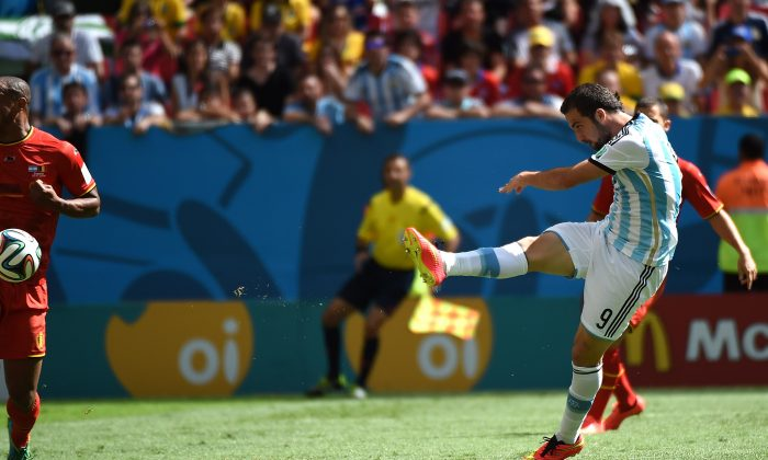 Argentina's forward Gonzalo Higuain (R) kicks to score his team's first goal during a quarter-final football match between Argentina and Belgium at the Mane Garrincha National Stadium in Brasilia during the 2014 FIFA World Cup on July 5, 2014. (CHRISTOPHE SIMON/AFP/Getty Images)