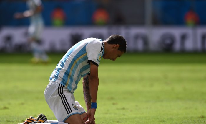 Argentina's midfielder Angel Di Maria reacts during a quarter-final football match between Argentina and Belgium at the Mane Garrincha National Stadium in Brasilia during the 2014 FIFA World Cup on July 5, 2014. (PEDRO UGARTE/AFP/Getty Images)
