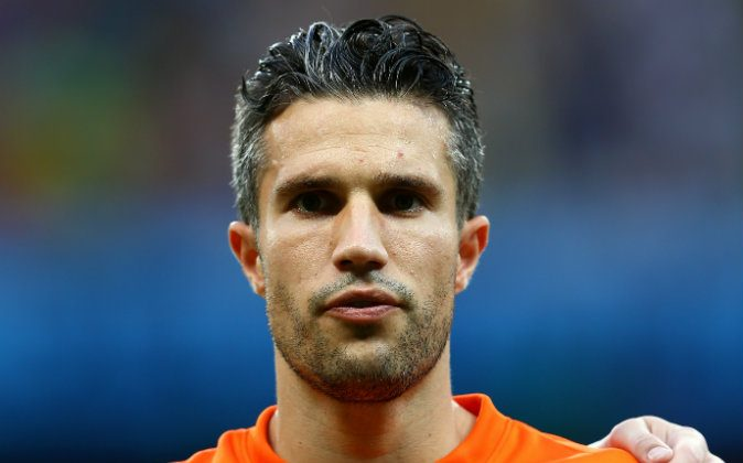 Robin van Persie of the Netherlands looks on during the National Anthem prior to the 2014 FIFA World Cup Brazil Quarter Final match between the Netherlands and Costa Rica at Arena Fonte Nova on July 5, 2014 in Salvador, Brazil. (Photo by Michael Steele/Getty Images)