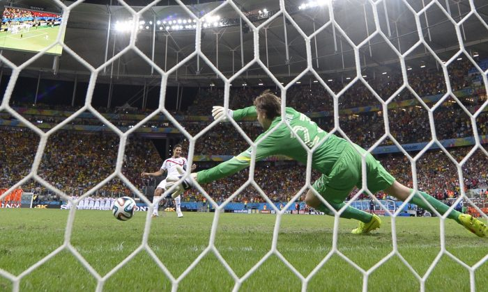 Netherlands' goalkeeper Tim Krul (R) fails to make a save from Costa Rica's midfielder Celso Borges during a penalty shoot-out after extra-time during a quarter-final football match between Netherlands and Costa Rica at the Fonte Nova Arena in Salvador during the 2014 FIFA World Cup on July 5, 2014. (FABRICE COFFRINI/AFP/Getty Images)