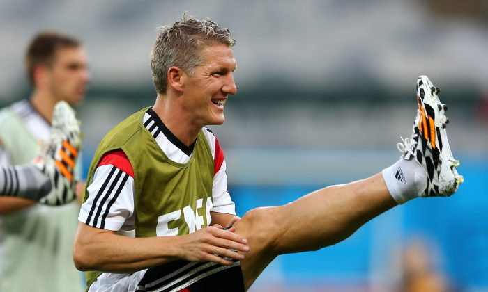 Bastian Schweinsteiger of Germany stretches during the German national team training at Estadio Mineirao on July 7, 2014 in Belo Horizonte, Brazil. (Martin Rose/Getty Images)