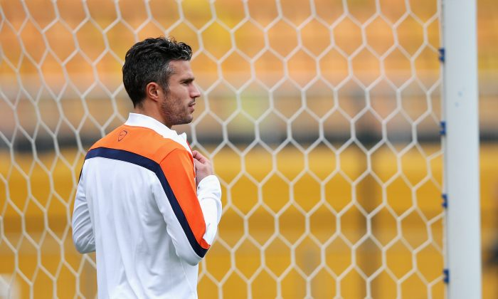 Robin van Persie looks on during the Netherlands training session at the 2014 FIFA World Cup Brazil held at the Estadio Paulo Machado de Carvalho Pacaembu on July 8, 2014 in Sao Paulo, Brazil. (Dean Mouhtaropoulos/Getty Images)