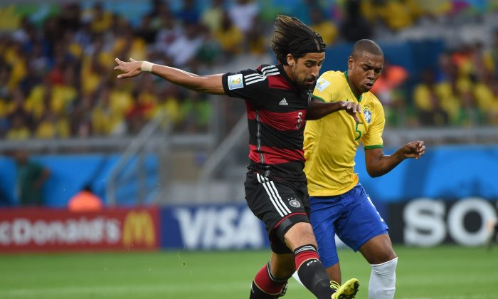 Brazil's midfielder Fernandinho (R) challenges Germany's midfielder Sami Khedira during the semi-final football match between Brazil and Germany at The Mineirao Stadium in Belo Horizonte on July 8, 2014, during the 2014 FIFA World Cup . (PEDRO UGARTE/AFP/Getty Images)