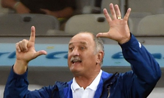 Brazil's coach Luiz Felipe Scolari gestures during the semi-final football match between Brazil and Germany at The Mineirao Stadium in Belo Horizonte on July 8, 2014, during the 2014 FIFA World Cup . (PEDRO UGARTE/AFP/Getty Images)