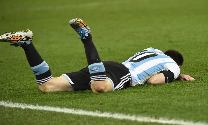 Argentina's forward and captain Lionel Messi reacts after a challenge during the semi-final football match between Netherlands and Argentina of the FIFA World Cup at The Corinthians Arena in Sao Paulo on July 9, 2014.  (PEDRO UGARTE/AFP/Getty Images)