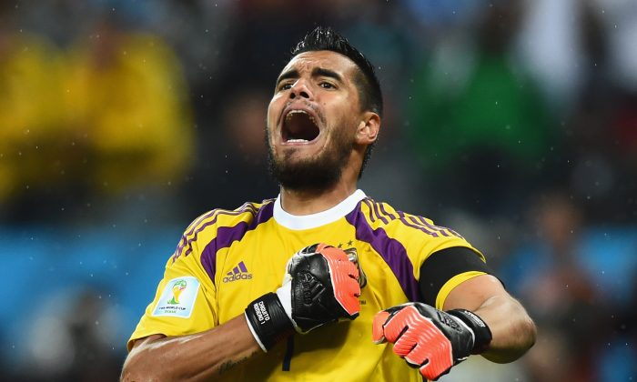 Sergio Romero of Argentina celebrates defeating the Netherlands in a shootout during the 2014 FIFA World Cup Brazil Semi Final match between the Netherlands and Argentina at Arena de Sao Paulo on July 9, 2014 in Sao Paulo, Brazil. (Matthias Hangst/Getty Images)