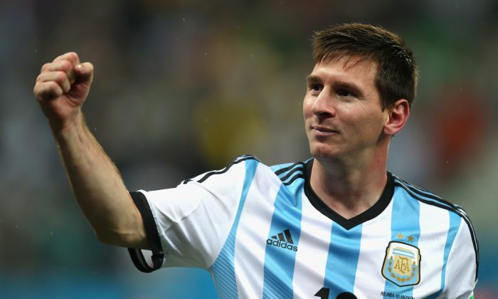 Lionel Messi of Argentina celebrates defeating the Netherlands in a shootout during the 2014 FIFA World Cup Brazil Semi Final match between the Netherlands and Argentina at Arena de Sao Paulo on July 9, 2014 in Sao Paulo, Brazil. (Photo by Clive Rose/Getty Images)