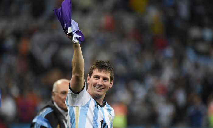 Argentina's forward and captain Lionel Messi celebrates after winning their FIFA World Cup semi-final match against the Netherlands in a penalty shoot-out following extra time at The Corinthians Arena in Sao Paulo on July 9, 2014. (ODD ANDERSEN/AFP/Getty Images)