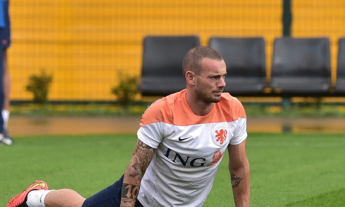 Netherlands' midfielder Wesley Sneijder stretches on the training pitch at The Estádio Paulo Machado de Carvalho (Pacaembu) in Sao Paulo on July 10, 2014, ahead of their third place play-off against host nation Brazil in the 2014 FIFA World Cup. Despite their World Cup semi-final elimination on penalties by Argentina, the Netherlands and their coach Louis van Gaal will move on from the tournament with their reputations unquestionably enhanced. (NELSON ALMEIDA/AFP/Getty Images)