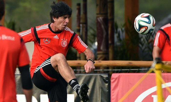Germany's coach Joachim Loew controls the ball during a training session of Germany's national football team in Santo Andre on July 10, 2014 ahead of the final match Argentina vs Germany on July 13, for the 2014 FIFA World Cup football tournament. (PATRIK STOLLARZ/AFP/Getty Images)