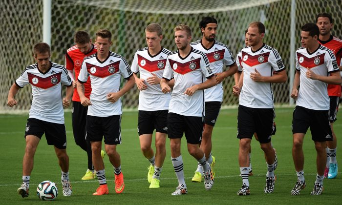 Germany´s players warm up during a training session in Santo Andre on July 10, 2014, ahead of the final match Argentina vs Germany on July 13, during the 2014 FIFA World Cup football tournament. (PATRIK STOLLARZ/AFP/Getty Images)