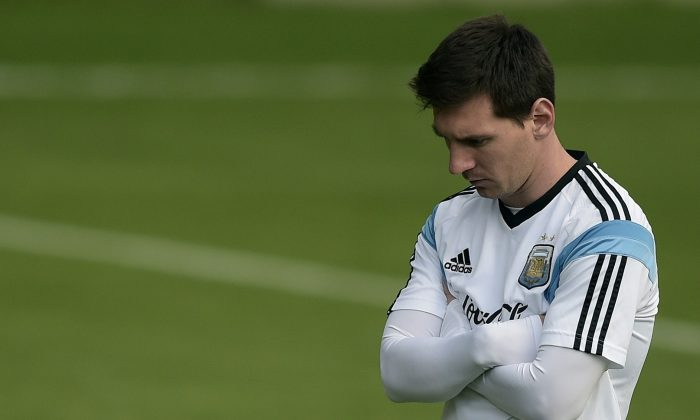 Argentina's forward Lionel Messi looks on during a training session at 'Cidade do Galo', their base camp in Vespasiano, near Belo Horizonte, some 470 Km north of Rio de Janeiro, Brazil on July 10, 2014, ahead the 2014 FIFA World Cup final football match against Germany to be held at The Maracana Stadium in Rio de Janeiro on July 13. (JUAN MABROMATA/AFP/Getty Images)