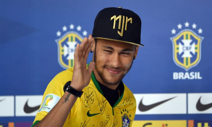 Brazil's forward Neymar gestures during a press conference in Teresopolis on July 10, 2014, during the FIFA World Cup. Brazil will face Netherlands on July 12, in the third place play-off for the FIFA World Cup tournament at The Mané Garrincha National Stadium in Brasilia. (VANDERLEI ALMEIDA/AFP/Getty Images)