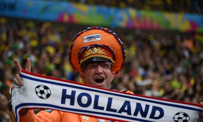 A Netherlands fan cheers for his team during the third place play-off football match between Brazil and Netherlands during the 2014 FIFA World Cup at the National Stadium in Brasilia on July 12, 2014. (Vanderlei Almeida/AFP/Getty Images)