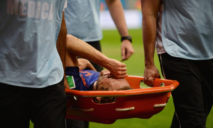 Daley Blind of the Netherlands is stretchered off the field during the 2014 FIFA World Cup Brazil Third Place Playoff match between Brazil and the Netherlands at Estadio Nacional on July 12, 2014 in Brasilia, Brazil. (Photo by Jamie McDonald/Getty Images)