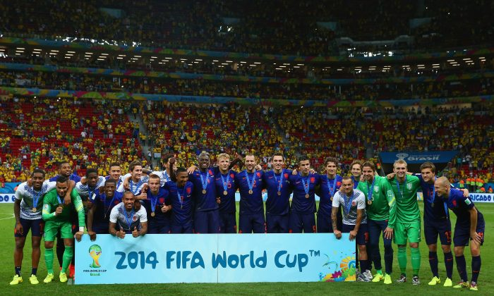 The Netherlands celebrate with their medals after defeating Brazil 3-0 in the 2014 FIFA World Cup Brazil Third Place Playoff match between Brazil and the Netherlands at Estadio Nacional on July 12, 2014 in Brasilia, Brazil. (Photo by Robert Cianflone/Getty Images)