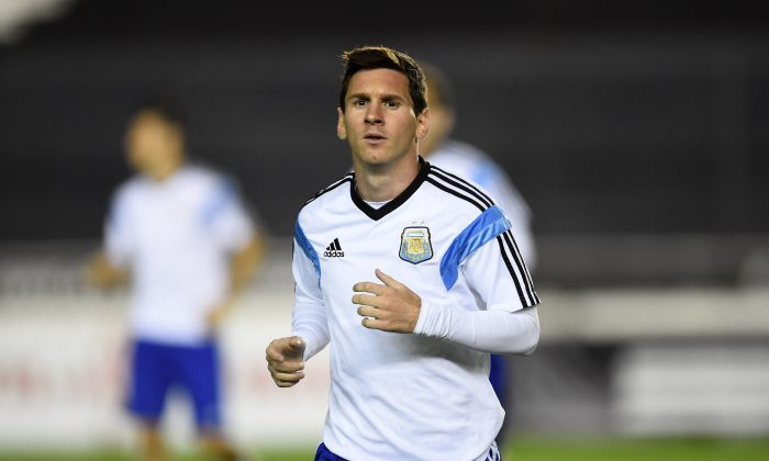 Lionel Messi of Argentina warms up during the Argentina training session, ahead of the 2014 FIFA World Cup Final, at Estadio Sao Januario on July 12, 2014 in Rio de Janeiro, Brazil. (Matthias Hangst/Getty Images)