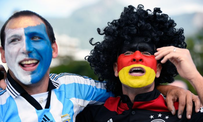 Argentina and Germany fans cheer prior to the 2014 FIFA World Cup final football match between Germany and Argentina at the Maracana Stadium in Rio de Janeiro, Brazil on July 13, 2014. (Pedro Ugarte/AFP/Getty Images)