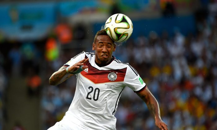 Germany's defender Jerome Boateng heads the ball during the 2014 FIFA World Cup final football match between Germany and Argentina at the Maracana Stadium in Rio de Janeiro on July 13, 2014. (ODD ANDERSEN/AFP/Getty Images)